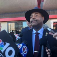 Commissioner William Gross talks to reporters after the meeting between law enforcement officials and liquor license owners in Boston. (Jerome Campbell/WBUR)