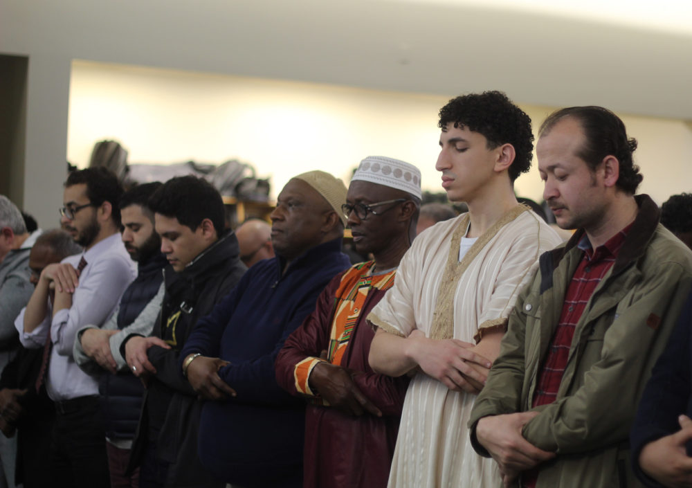 Worshipers gather inside the Islamic Society of Boston Cultural Center on Friday. (Quincy Walters/WBUR)