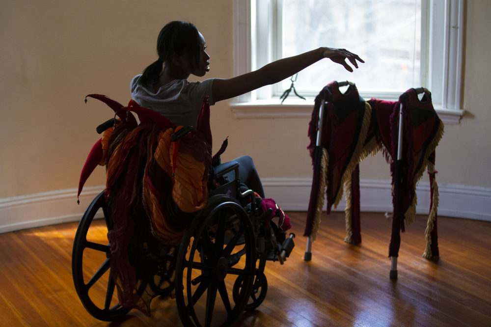 Ellice Patterson dances in a wheelchair at her studio in Brookline. (Jesse Costa/WBUR)