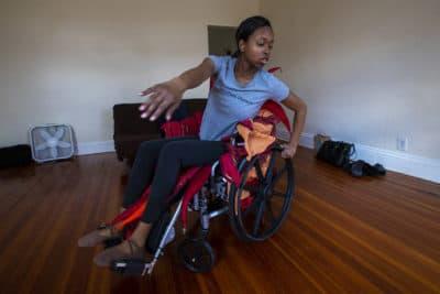 Ellice Patterson dances in her wheelchair at her home in Brookline. (Jesse Costa/WBUR)