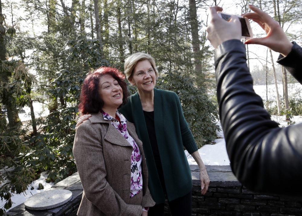 Sen. Elizabeth Warren, D-Mass., right, poses for a photo with a guest at the campaign house party in Salem, N.H. (Elise Amendola/AP)