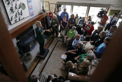 Democratic presidential candidate Sen. Elizabeth Warren, D-Mass., left, speaks at a campaign house party on March 15 in Salem, N.H. (Elise Amendola/AP)