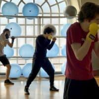 Harvard junior José Larios (center) during a workout with the boxing club. (Max Larkin/WBUR)