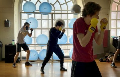 Harvard junior José Larios (center) during a workout with the boxing club. (Max Larkin/WBUR)