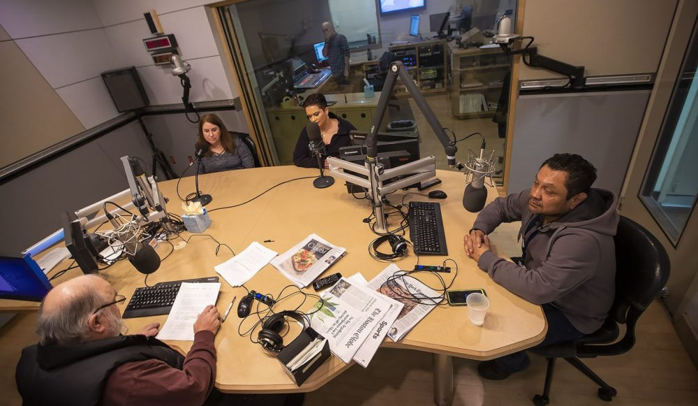 From left: Laurene Trio of Medford, Keri Rodrigues of Medford and Rodolfo Aguilar of Hyde Park speak with Bob Oakes in the studio. (Jesse Costa/WBUR)