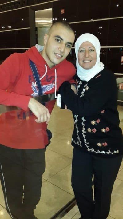 Omar Zarzour hugs his mom goodbye at an airport in Jordan. (Courtesy Omar Zarzour)