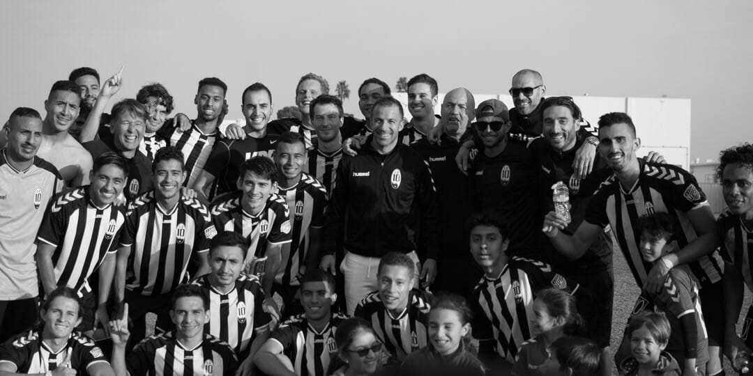 Omar Zarzour, and his teammates, pose for a picture with Alessandro Del Piero. (Courtesy Omar Zarzour)