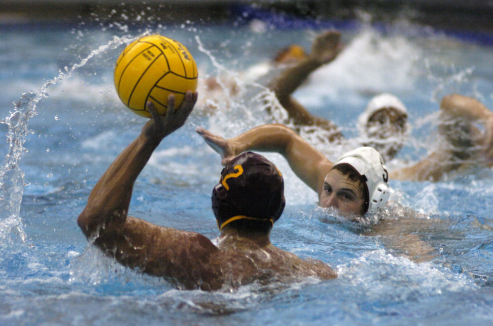 A USC water polo player prepares to pass in a 2005 game. (Ralph Wilson/AP)