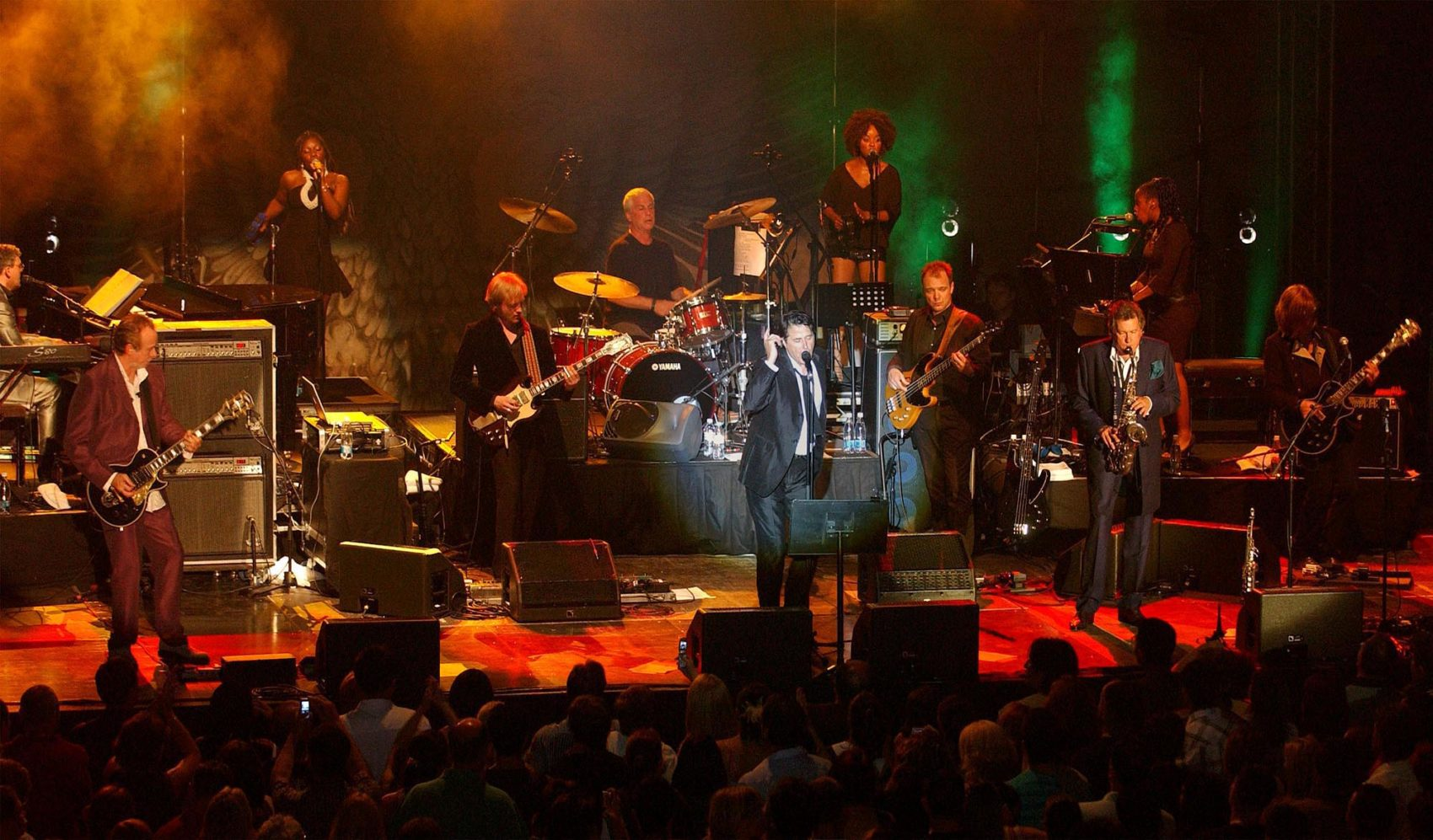 Brian Ferry, center, performs during a concert of the British pop band Roxy Music in Macedonia's southwestern town of Ohrid on July 14, 2006. (Boris Grdanoski/AP)