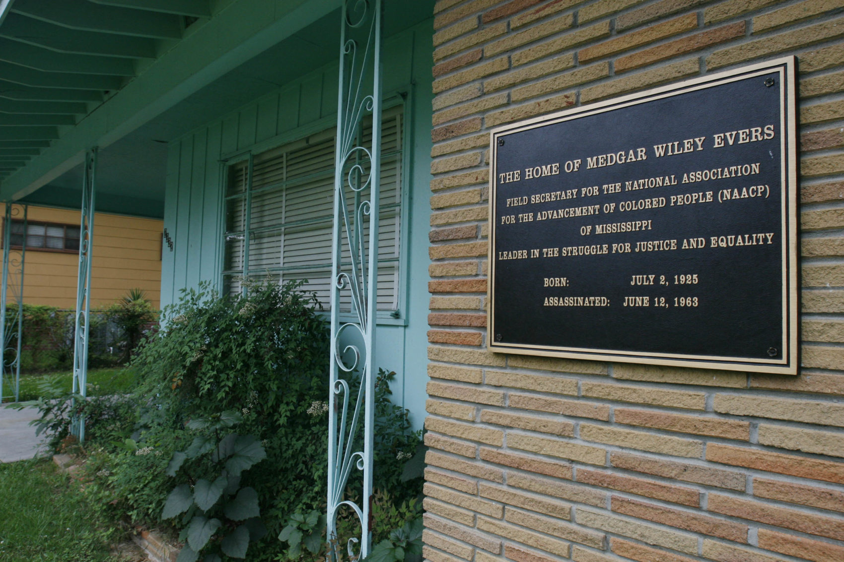 A plaque decorates the front of the home of the late civil rights activist Medgar Evers in Jackson, Miss. (Rogelio V. Solis/AP)