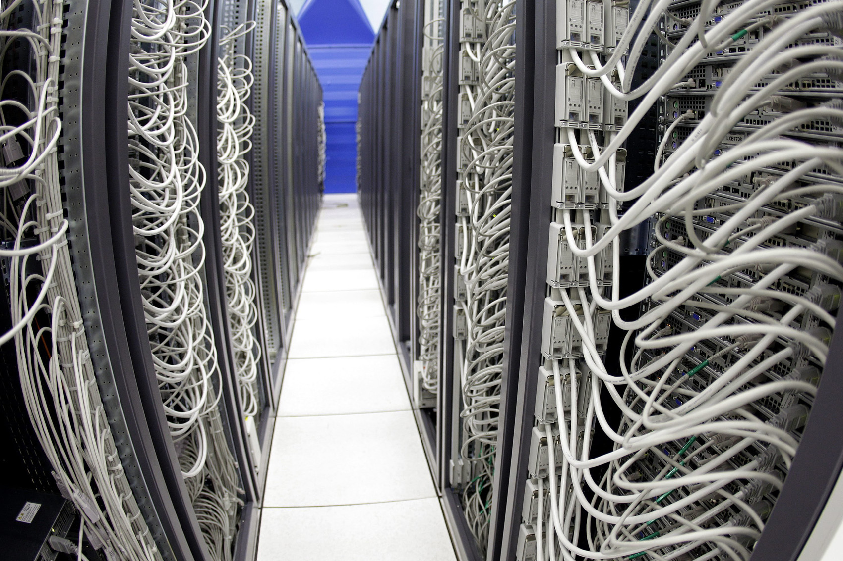 Cables connect server racks in the computer centre of the Cern, the European Organization for Nuclear Research, near Geneva, on Thursday, Oct. 2, 2008. (AP Photo/KEYSTONE/Martial Trezzini)