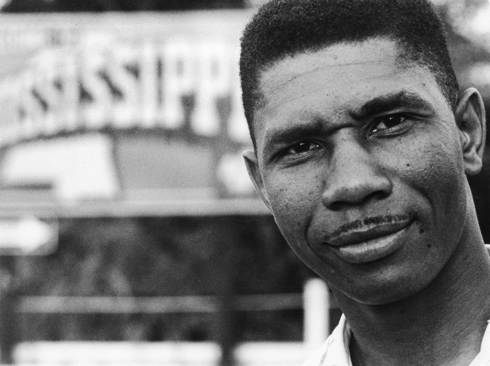 Medgar Evers, civil rights activist and the NAACP's first field secretary, stands near a sign of the state of Mississippi in 1958. (Francis H. Mitchell - Ebony Collection/AP)