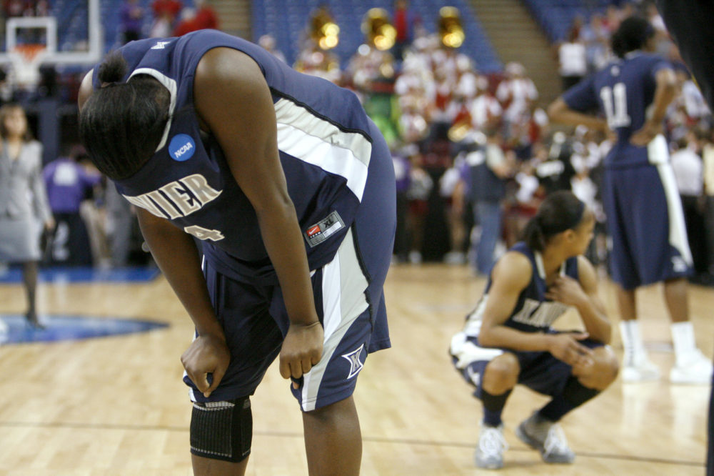 Xavier guard Dee Dee Jernigan, left, and teammates react to a 55-53 loss to Stanford in the final of the NCAA college basketball tournament Sacramento Regional in Sacramento, Calif., Monday, March 29, 2010. (Steve Yeater/AP)