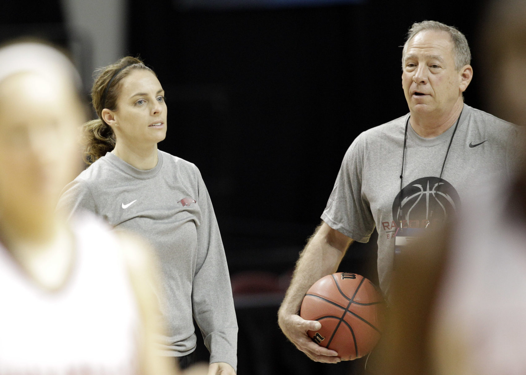 Tom and Nicki coaching together at the University of Arkansas. (David J. Phillip/AP)