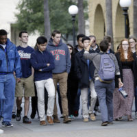 A group tours the campus at Stanford University Wednesday, Jan. 13, 2016, in Stanford, Calif. (Marcio Jose Sanchez/AP)