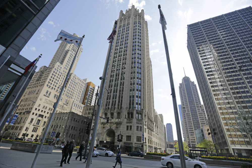 The Chicago Tribune Tower, center, can be seen on Michigan Avenue, Monday, April 25, 2016, in Chicago, Ill. (M. Spencer Green/AP)