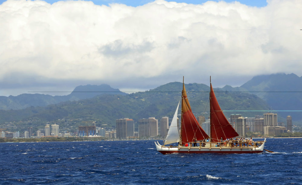 In this April 29, 2014 file photo, the Hokulea sailing canoe is seen off Honolulu. The Polynesian voyaging canoe is returning to Hawaii after a three-year journey around the world guided only by nature with navigators using no modern navigation to guide Hokulea across 40,000 nautical miles to 19 countries. Thousands are expected to welcome the double-hulled canoe to Oahu, Hawaii, on Saturday, June 17, 2017. (AP Photo/Sam Eifling, File)