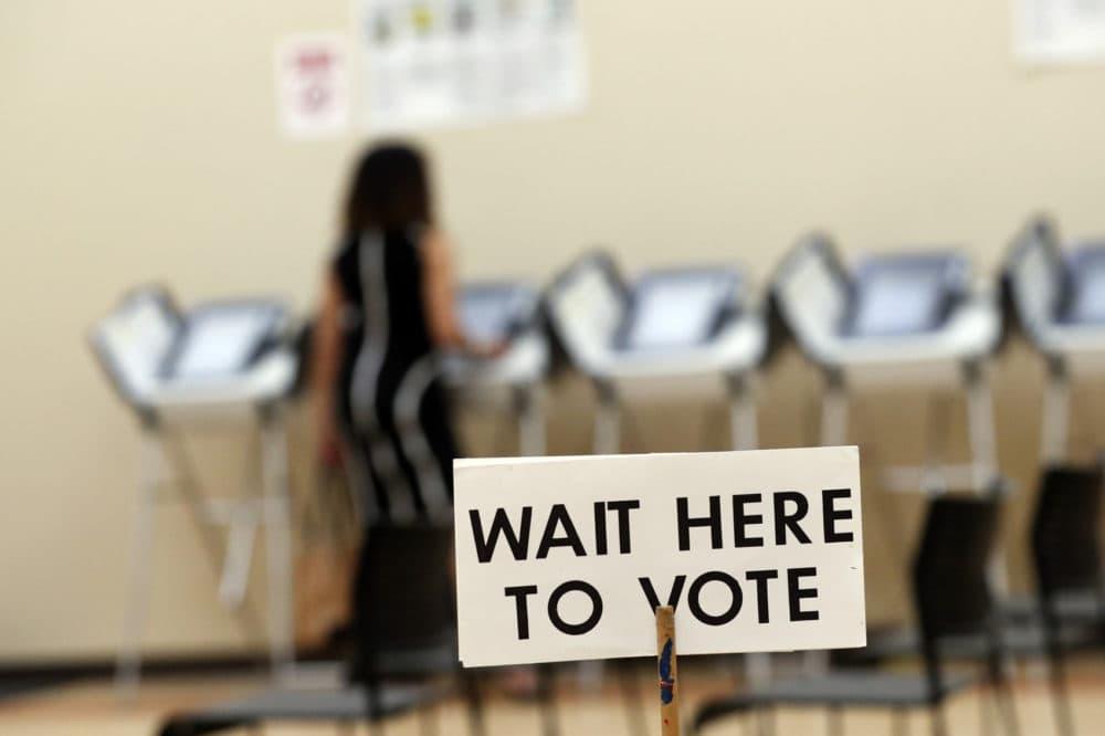 In this Wednesday, May 9, 2018, photo, Pamela Hampton votes in Sandy Springs, Ga. (John Bazemore/AP)