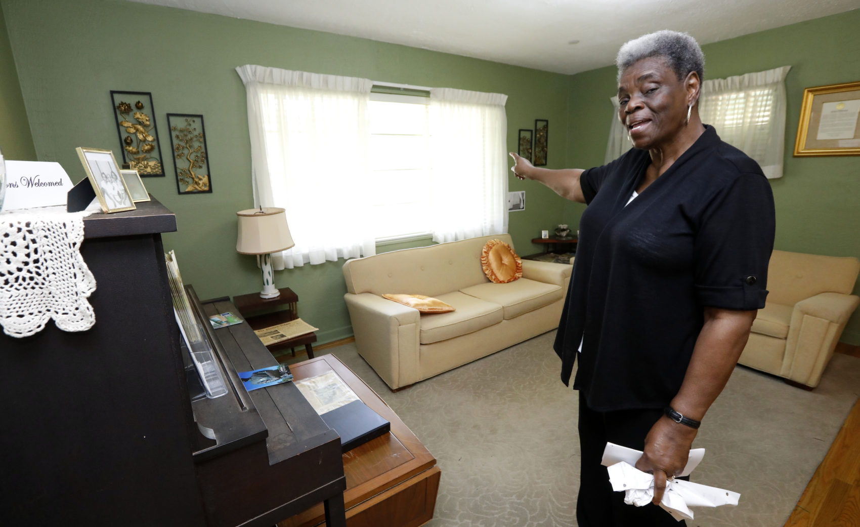 Minnie White Watson, curator of the Medgar and Myrlie Evers house in Jackson, Miss., speaks about the various times when the house was shot at, Thursday, May 24, 2018 in Jackson, Miss. (Rogelio V. Solis/AP)