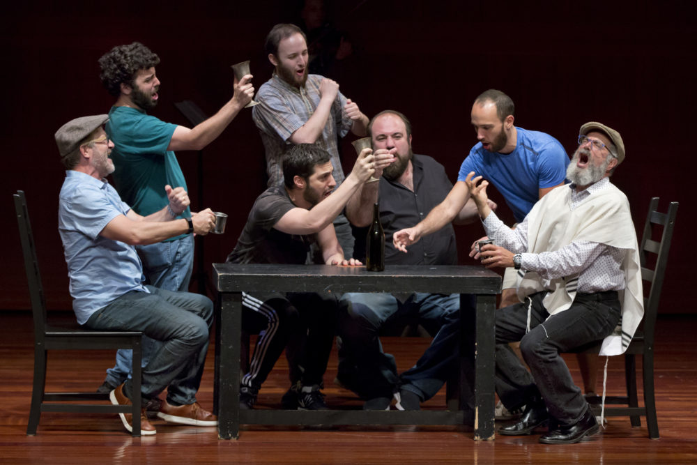 "Steven Skybell, right, as Tevye, rehearses with the National Yiddish Theatre Folksbiene cast of a Yiddish-language version of ""Fiddler on the Roof,"" at the at the Museum of Jewish Heritage in New York on June 19, 2018. (Richard Drew/AP)"