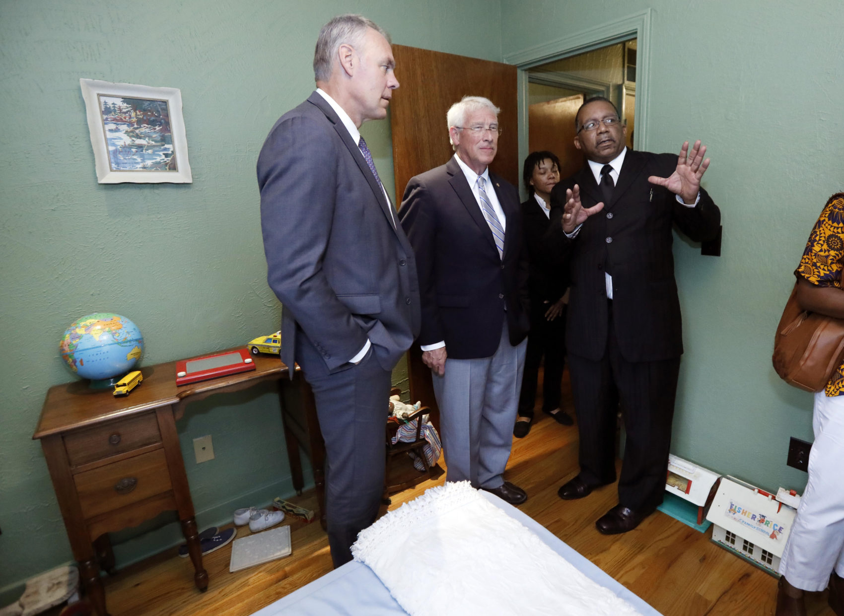 Charles Murchinson of Jackson, right, tells U.S. Sen. Roger Wicker, R-Miss., center and Interior Secretary Ryan Zinke, about the makeup of the neighborhood that the late civil rights activist Medgar and Myrlie Evers lived at in Jackson, Miss., Friday, Aug. 3, 2018. (Rogelio V. Solis/AP)
