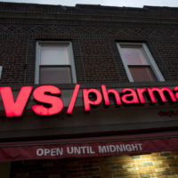 FILE- This Dec. 3, 2017, file photo shows a CVS Pharmacy in the Brooklyn borough of New York. CVS Health reports earnings Wednesday, Aug. 8, 2018. (AP Photo/Mark Lennihan, File)