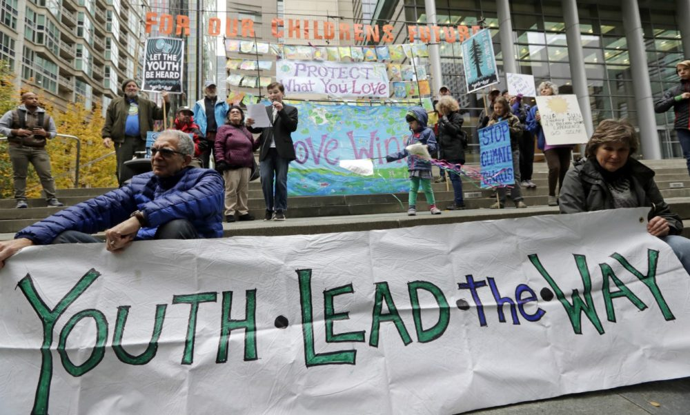 Alex Sayres, 12, speaks during a rally by youth activists and others in support of a climate change lawsuit, Monday, Oct. 29, 2018, in Seattle. (Elaine Thompson/AP)