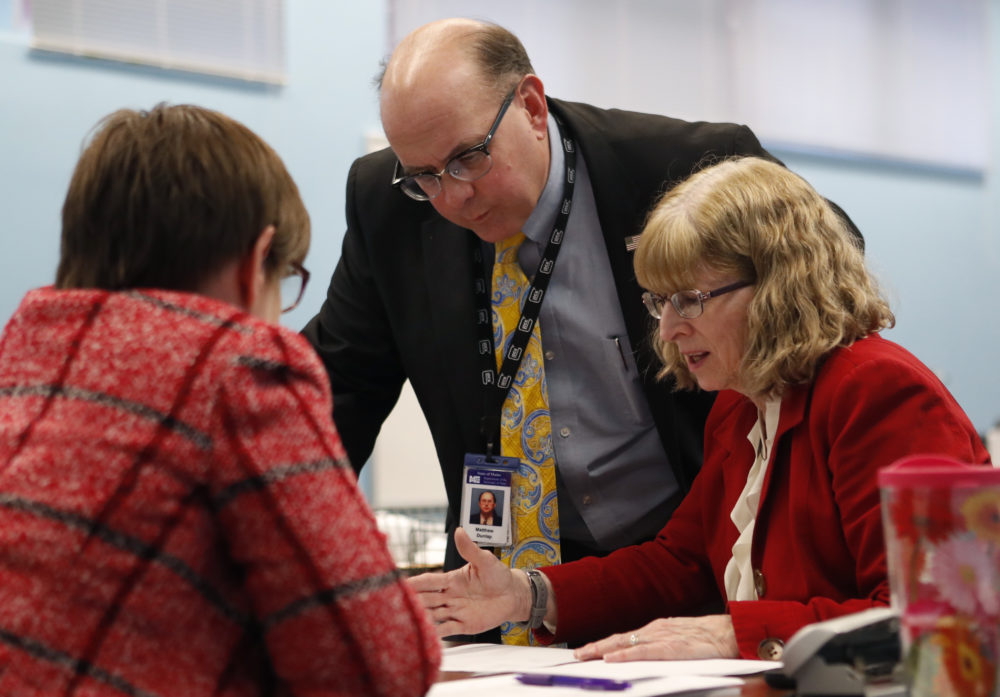 Maine Secretary of State Matthew Dunlap works with Deputy Secretary of State Julie Flynn, right, during the ballot-tabulation process for Maine's Second Congressional District's House election, Tuesday, Nov. 13, 2018, in Augusta, Maine. The election is the first congressional race in American history to be decided by the ranked-choice voting method that allows second choices. (Robert F. Bukaty/AP)