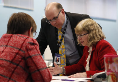 On Nov. 13, 2018, Maine election officials work during the election in the state's 2nd Congressional District, the first congressional race in American history to be decided by the ranked-choice voting method that allows second choices. (Robert F. Bukaty/AP)