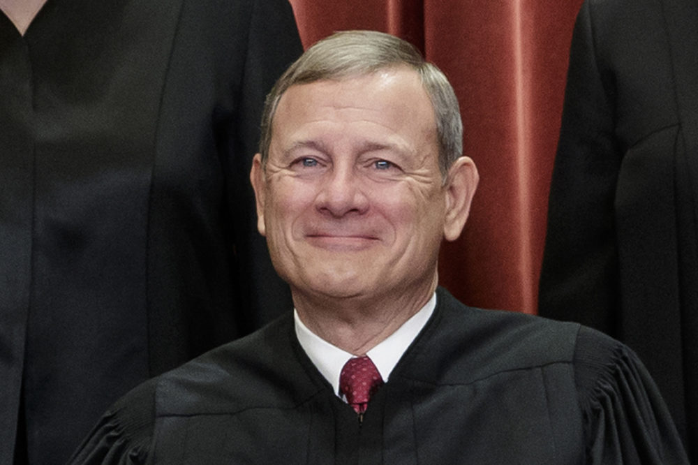 Chief Justice of the United States, John G. Roberts, nominated by President George W. Bush, sits with fellow Supreme Court justices for a group portrait at the Supreme Court Building in Washington, Friday, Nov. 30, 2018. (J. Scott Applewhite/AP)