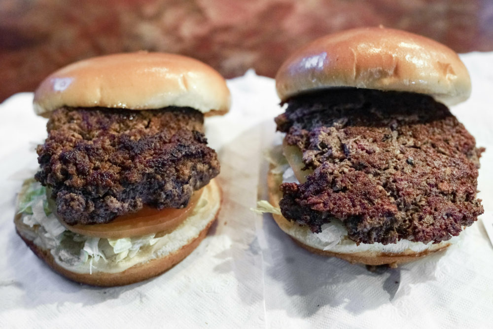 "On the left, a conventional beef burger. On the right, ""The Impossible Burger,"" a plant-based burger containing wheat protein, coconut oil and potato protein among. (Nati Harnik/AP)"