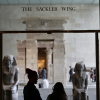 A sign with the Sackler name is displayed at the Metropolitan Museum of Art in New York, Thursday, Jan. 17, 2019. (Seth Wenig/AP)