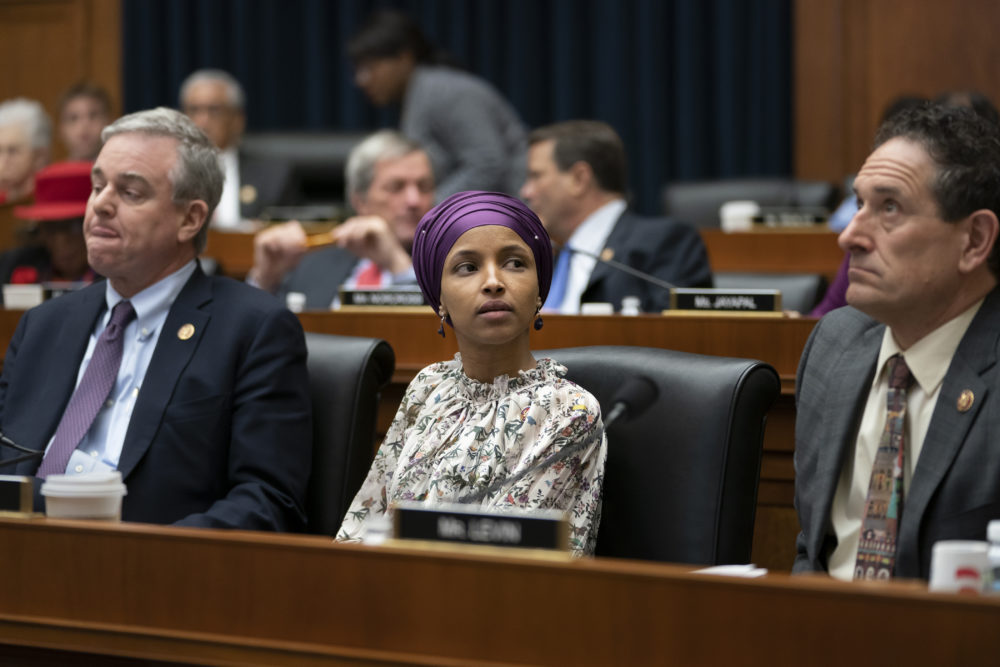 Rep. Ilhan Omar, D-Minn., sits with fellow Democrats, Rep. David Trone, D-Md., left, and Rep. Andy Levin, D-Mich., right, on the House Education and Labor Committee during a bill markup, on Capitol Hill in Washington, Wednesday, March 6, 2019. (J. Scott Applewhite/AP)