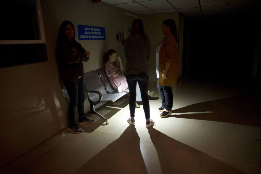 Mothers and relatives wait outside of an intense care room for babies at a clinic, during a power outage in Caracas, Venezuela, Thursday, March 7, 2019. (Ariana Cubillos/AP)
