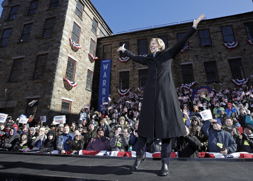 "U.S. Sen. Elizabeth Warren takes the stage during an event to formally launch her presidential campaign in Lawrence, Mass., on Feb. 9, 2019. Presidential candidates have used thematic songs to great effect in recent times. But it can also cause trouble if musicians object, and that's what Warren could be finding out is the case with Dolly Parton's ""9 to 5."" (Elise Amendola/AP)"