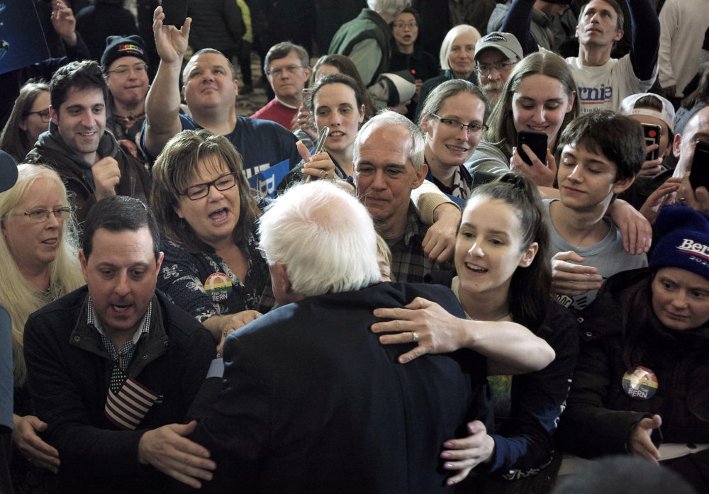 2020 Democratic presidential candidate Sen. Bernie Sanders, front, greets people in the audience after addressing a rally during a campaign stop Sunday, March 10, 2019, in Concord, N.H. (Steven Senne/AP)