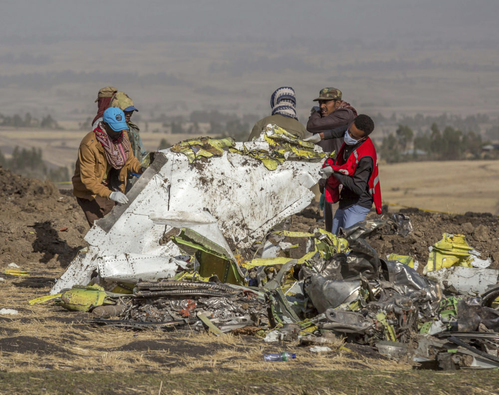 Rescuers work at the scene of an Ethiopian Airlines flight crash near Bishoftu, or Debre Zeit, south of Addis Ababa,  Ethiopia, Monday, March 11, 2019. (Mulugeta Ayene/AP)