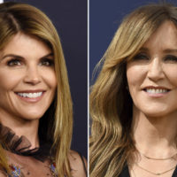 This combination photo shows actress Lori Loughlin at a Women's Cancer Research Fund event in Beverly Hills, Calif., on Feb. 27, 2018, left, and actress Felicity Huffman at the 70th Primetime Emmy Awards in Los Angeles on  Sept. 17, 2018. (AP Photo)