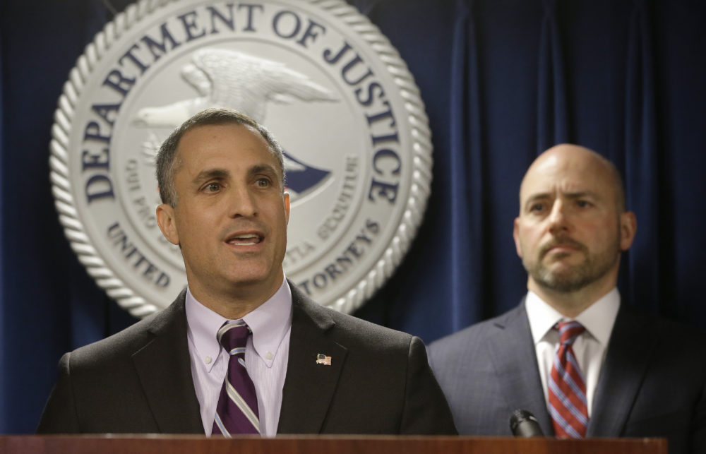 FBI Special Agent in Charge of Boston Joseph Bonavolonta, left, and Massachusetts U.S. Attorney Andrew Lelling face reporters as they announce indictments in a sweeping college admissions bribery scandal during a news conference Tuesday in Boston. (Steven Senne/AP)