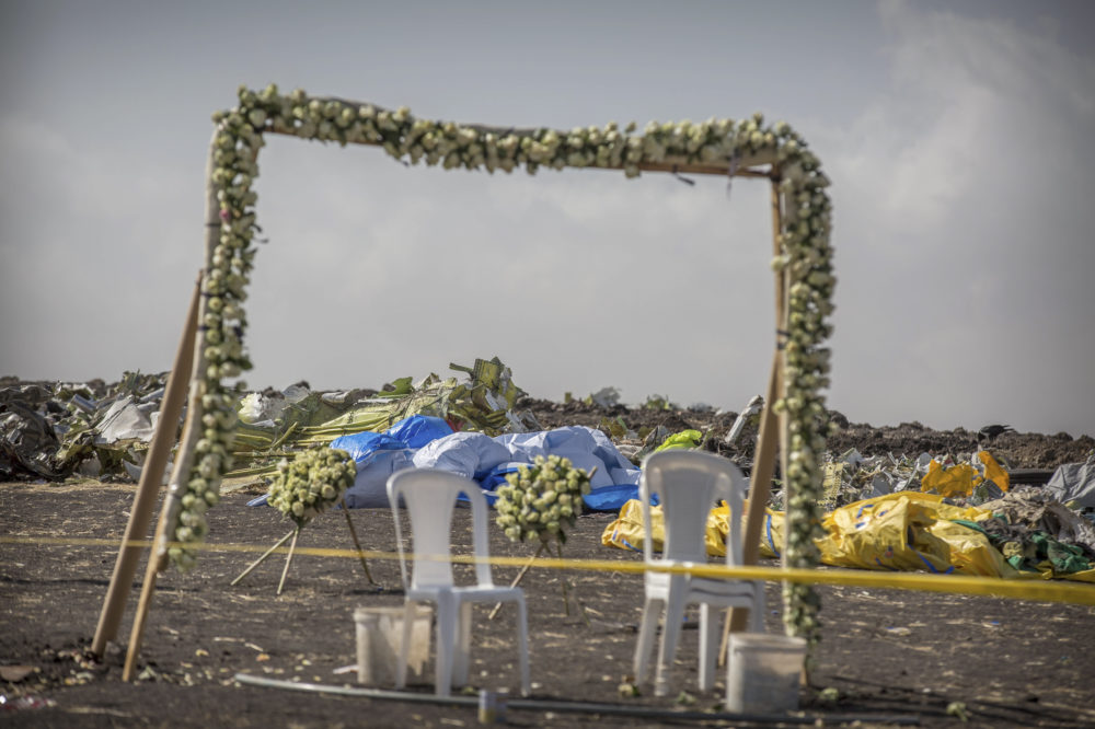 Wreaths and floral installations stand next to piles of wreckage at the scene where the Ethiopian Airlines Boeing 737 Max 8 crashed shortly after takeoff on Sunday killing all 157 on board. (Mulugeta Ayene/AP)