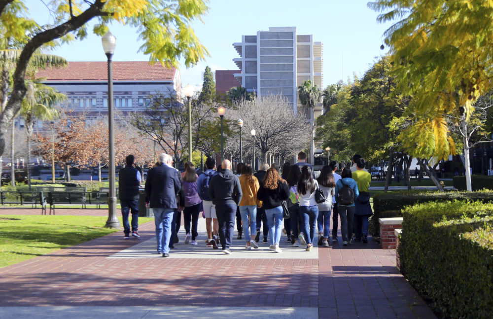 Prospective students and parents tour the University of Southern California campus. USC is one of many colleges moving swiftly to distance itself from the employees swept up in a nationwide college admissions scheme. (Reed Saxon/AP)