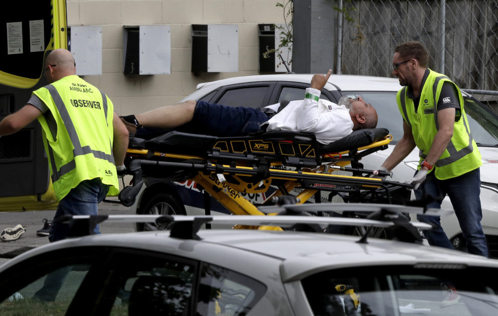 Ambulance staff take a man from outside a mosque in central Christchurch, New Zealand, Friday, March 15, 2019.  (Mark Baker/AP)