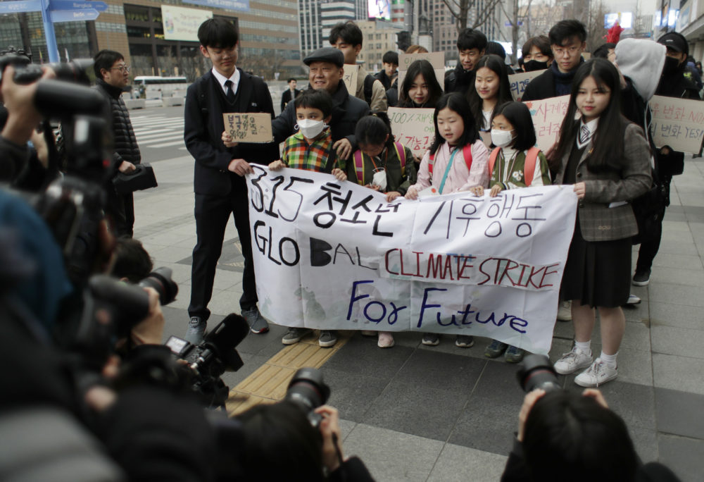 Participants march in Seoul, South Korea, Friday, March 15, 2019. About 150 students and other protesters attended a rally to protest their governments' failure to take sufficient action against climate change. (Lee Jin-man/AP)