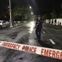 A police officer patrols near a mosque in central Christchurch, New Zealand Friday. (Mark Baker/AP)