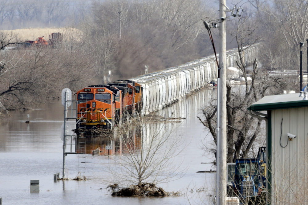A train sits in flood waters from the Platte River, in Plattsmouth, Neb., on Sunday, March 17, 2019. Hundreds of people remained evacuated from their homes in Nebraska. (Nati Harnik/AP)