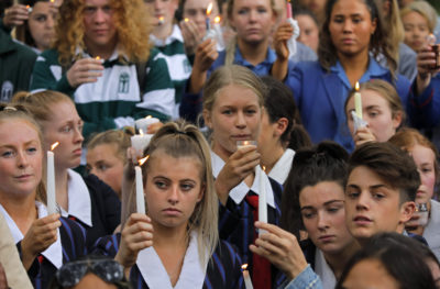 Students raise candles during a vigil outside the Al Noor mosque in Christchurch, New Zealand, on Monday, March 18, 2019. TAP Photo/Vincent Yu)