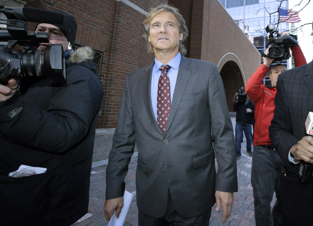 Jovan Vavic, former USC water polo coach, departs federal court in Boston on Monday, March 25, 2019, after facing charges in a college admissions bribery scandal. (Steven Senne/AP)