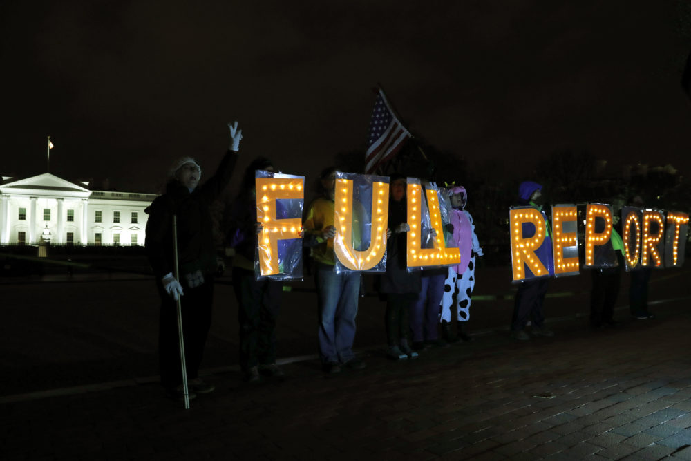 "Members of the protest group Herndon Reston Indivisible and Kremlin Annex hold signs saying ""Full Report,"" on Monday, March 25, 2019. (Jacquelyn Martin/AP)"