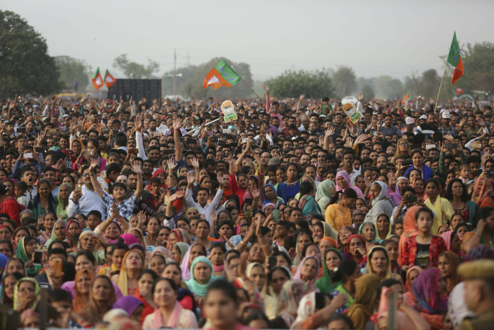 Bharatiya Janata Party (BJP) supporters attend an election rally addressed by Indian Prime Minister Narendra Modi at Dumi village in Akhnoor, about 20 kilometers from Jammu, India, Thursday, March 28, 2019. India's general elections will be held in seven phases starting April 11. (Channi Anand/AP)