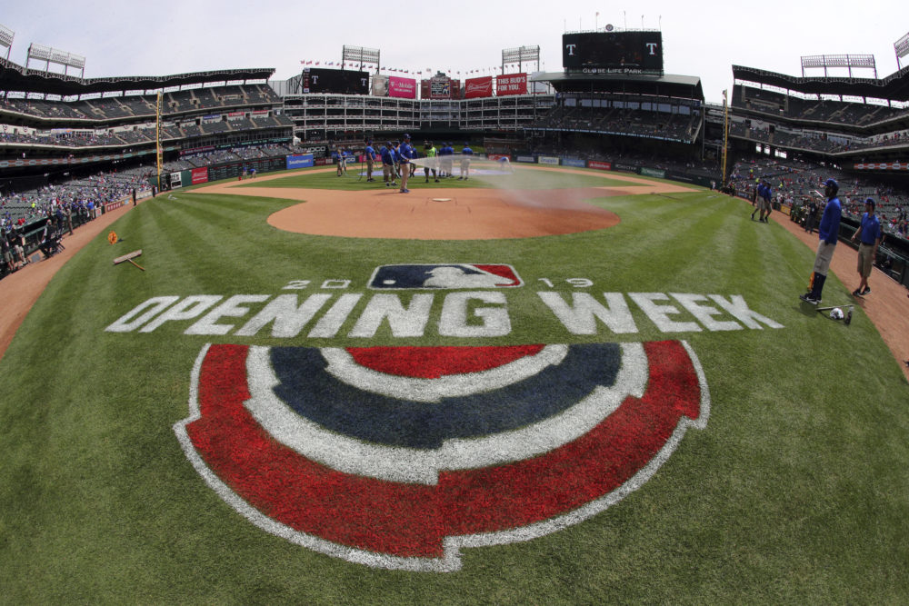 The grounds crew prepares the field for the opening day baseball game between the Chicago Cubs and the Texas Rangers Thursday, March 28, 2019 in Arlington, Texas. (Richard W. Rodriguez/AP)